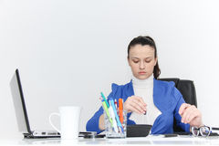 Young female designer working with architectural plan Stock Photo