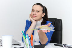 Young female designer working with architectural plan Royalty Free Stock Photo