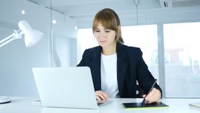 Young Female Designer working with Drawing tablet for a Computer royalty free stock photo