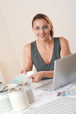 Young female designer working at office Royalty Free Stock Images