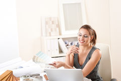 Young female designer working at office Royalty Free Stock Photos