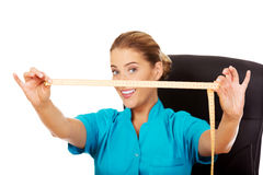 Young female dietician holding measure tape Royalty Free Stock Image