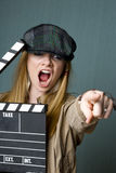 Young Female Director with slate pointing Stock Photo