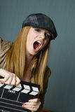 Young Female Director with slate yelling Royalty Free Stock Image