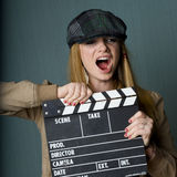 Young Female Director with slate yelling Stock Photo
