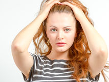Young female in distressed state of being Royalty Free Stock Images