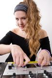 Young female dj playing Stock Photo