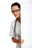 Young female doctor with banner. Royalty Free Stock Image