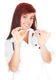 Young female doctor with broken cigarette Stock Image