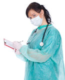 Young female doctor with clipboard Royalty Free Stock Photography