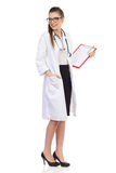 Young Female Doctor With Clipboard Looking Over Shoulder Stock Photo