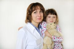Young female doctor with a cute little patient Royalty Free Stock Photos