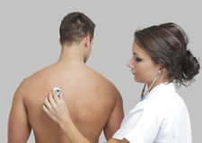 Young female doctor examining a male patient Stock Photo