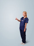 Young female doctor gesturing with copy space Stock Image