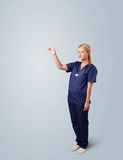 Young female doctor gesturing with copy space Stock Images