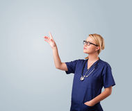 Young female doctor gesturing with copy space Stock Photos