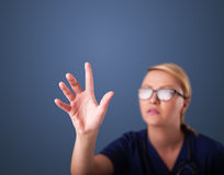 Young female doctor gesturing with copy space Royalty Free Stock Photography