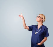Young female doctor gesturing with copy space Royalty Free Stock Image