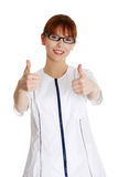 Young female doctor gesturing ok Royalty Free Stock Images
