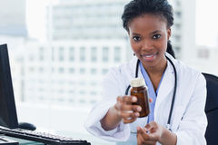 Young female doctor giving medication Stock Photos