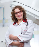 Young female doctor in glasses in medical laboratory. And pressure chamber behind Royalty Free Stock Photo