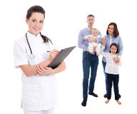 Young female doctor and happy family isolated on white Stock Photo