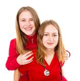 Young female doctor and her sister. Having fun Royalty Free Stock Photos