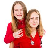 Young female doctor and her sister. Having fun Royalty Free Stock Photography