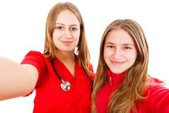 Young female doctor and her sister. Portrait photo of young female doctor and her sister Royalty Free Stock Images