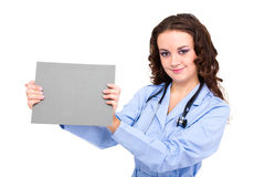 Young female doctor holding a blank Stock Photography