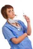 Young female doctor holding filled syringe Stock Images