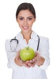 Young Female Doctor Holding Green Apple Royalty Free Stock Photos