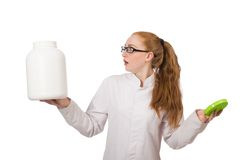 Young female doctor holding jar of protein Royalty Free Stock Photos