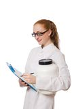 Young female doctor holding jar of protein Stock Image