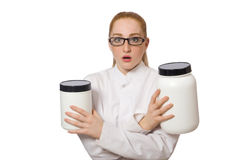 The young female doctor holding jar of protein isolated on white Stock Images