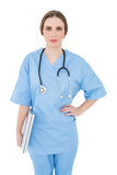 Young female doctor holding a notebook and looking into the camera Stock Photos
