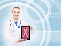 Young female doctor holding a tablet Royalty Free Stock Photography