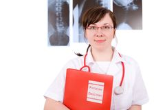 Young female doctor holds red folder, x-rays stock photography