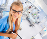 Young female doctor in ICU royalty free stock image