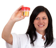 Young female doctor keeping urine to analysis Stock Photos