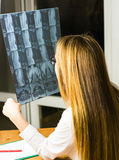 Young female doctor looking at the x-ray picture in hospital Royalty Free Stock Photos