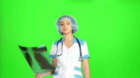 Young female doctor looking at the x-ray picture stock footage
