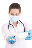 Young female doctor in mask giving pills over white Stock Image