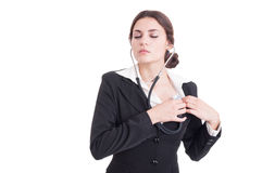 Young female doctor or medic listening her heart with stethoscop Stock Image