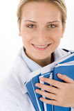 Young female doctor with medical files on white Stock Photo