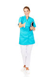 Young female doctor or nurse holding black notes Royalty Free Stock Photography