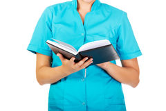 Young female doctor or nurse holding black notes Royalty Free Stock Images