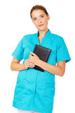 Young female doctor or nurse holding black notes Stock Images