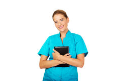 Young female doctor or nurse holding black notes Royalty Free Stock Image