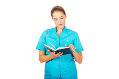 Young female doctor or nurse holding black notes Royalty Free Stock Photos
